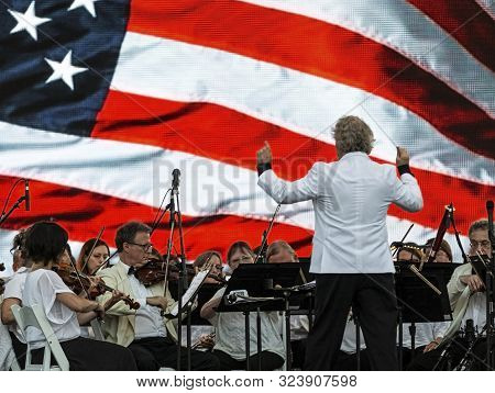 East Islip, Ny, Usa - 13 July 2019: The Long Island Concert Orchestra Performs For Free At Night At