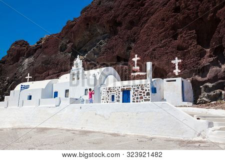 Santorini, Greece - April, 2018: Tourist Taking Pictures Of The Saint Nikolaos Orthodox Church Locat