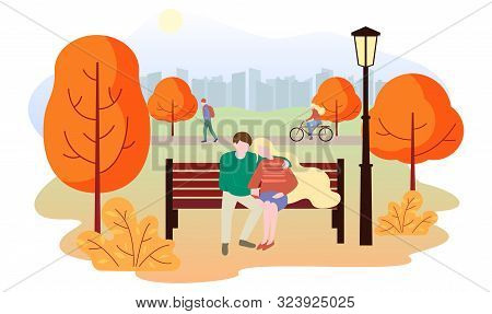 City Autumn Park Landscape. People Walk In The Park, Rides A Bicycle, A Couple In Love Sits On A Ben