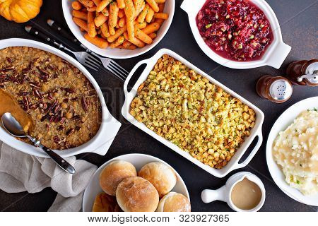 Variety Of Thanksgiving Sides On The Dinner Table, Carrots, Mashed Potatoes, Sweet Potato Casserole
