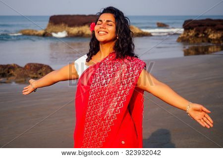 Portrait Of Attractive Indian Female Model In Vacation On Paradise Tropical Beach By Ocean Sea. Hind