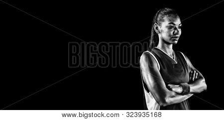 Digital Composite of Tough female basketball player