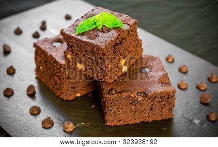 Dark Chocolate And Cocoa Brownie Fudge Cakes Dessert On Black Background,