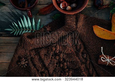 Handmade Knitted Clothes. Brown Aran Sweater With Chestnuts And Cinnamon.