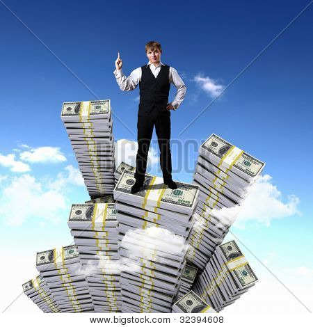 Young businessman with money symbols against blue skyy background