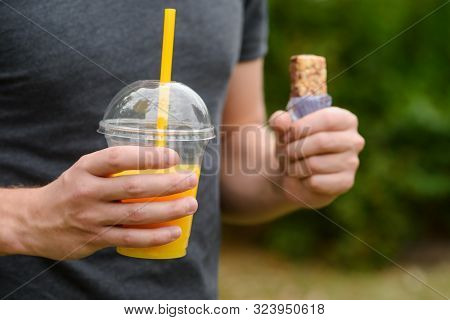 Tasty Snack With Granola Bar And Delicious Fresh Made Of Juicy Oranges. Male Hands Hold Food And Dri