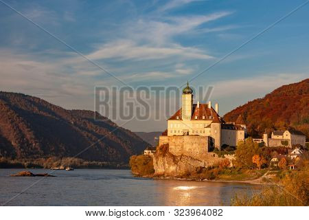 Small castle above the Danube in the romantic sunset, Austria