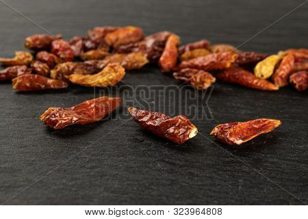 Lot Of Whole Dry Red Chili Pepper Peperoncino On Grey Stone