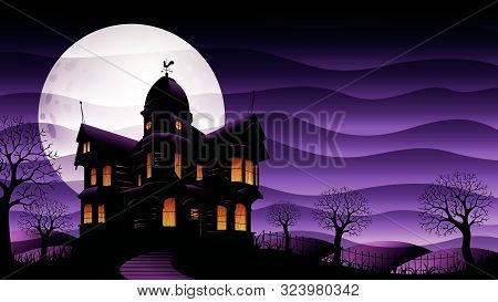 Old Haunted House With Yellow Lights On Surrounded By Silhouettes Of Trees With Big White Moon Behin