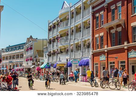Mackinac Island Mi /usa - July 9th 2016: Bustling Streets Of Downtown Mackinac Island During Tourist