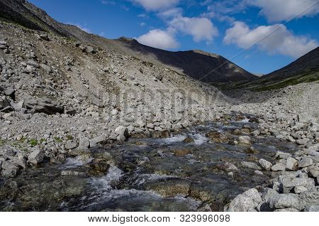 River In Mountain Valley In Khibiny Range, Mountains Above The Arctic Circle, Kola Peninsula, Russia