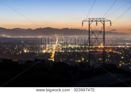 Predawn view of power lines entering the San Fernando Valley in Los Angeles California.  The San Gabriel Mountains are in background.