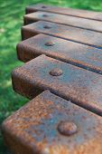closeup of a rusty table using shallow depth of field poster