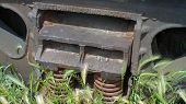 vintage steel train step with rusty spring coils poster