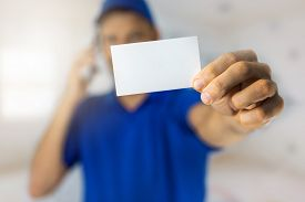 Handyman Services - Worker Showing Blank Business Card And Making A Phone Call