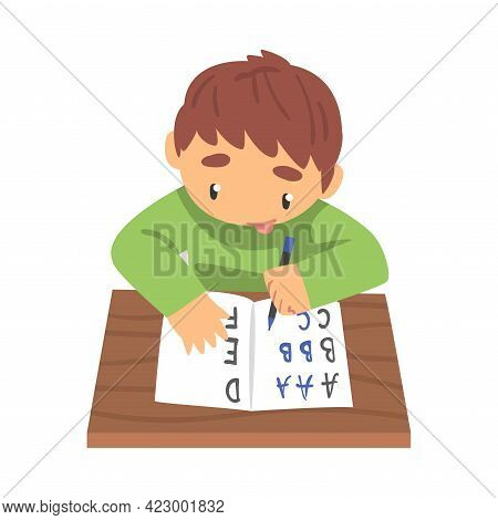 Adorable Little Boy Learning To Write, Elementary School Student Writing English Letters In Notebook