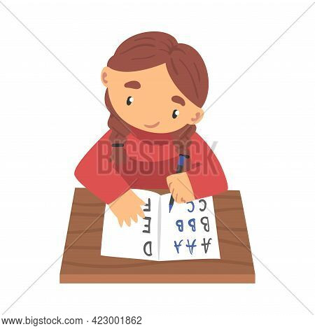 Lovely Little Girl Sitting At Desk And Writing Letters In Notebook, Elementary School Student Learni