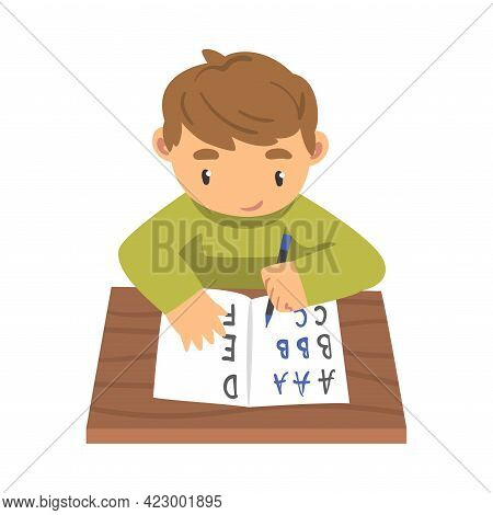 Little Girl Learning To Write, Elementary School Student Sitting At Desk And Writing Letters In Note