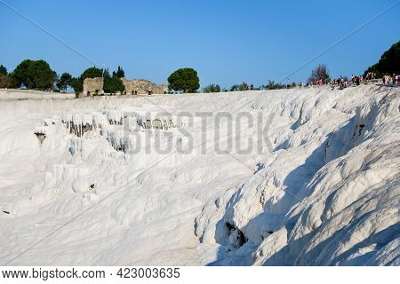 Travertine Cliff In Pamukkale, Turkey. Snow White Rocks & Terraces Were Formed During Centuries By F