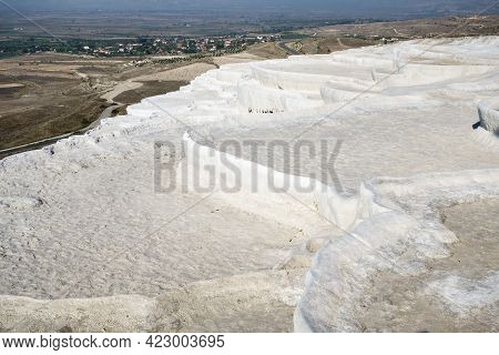 Panoramic View Onto Famous White Travertine Pools Of Pamukkale, Turkey. Some Of Them Have No Water B