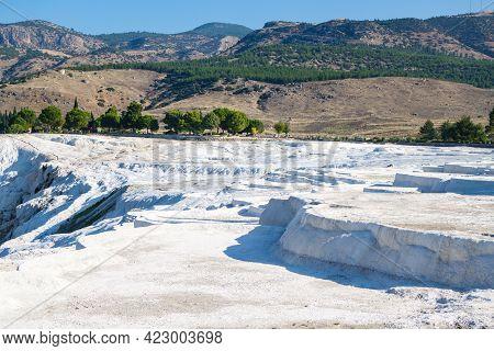 Panoramic View Onto Famous Snow White Travertine Terraces Of Pamukkale, Turkey. Mountains & Forest O