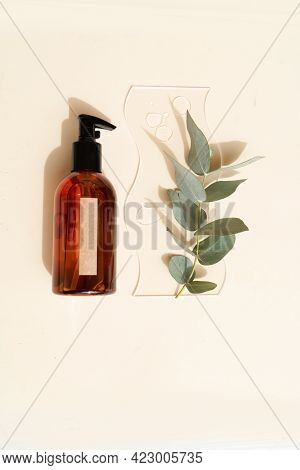 Glass Petri Dish With Transparent Pure Serum For Skin Care And Bottle Of Serum On Beige Background,