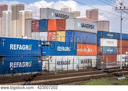 Container Terminal In Moscow. Stacked Cargo Containers Maersk, Cma Cgm, Refagro Waiting For Transpor