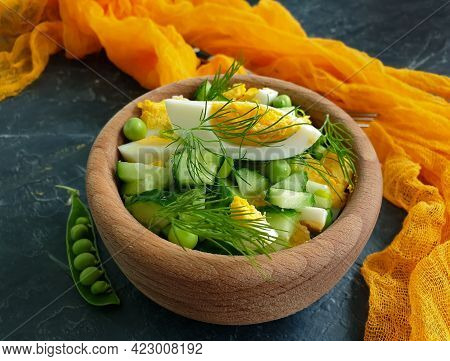 Salad Egg, Cucumber, Green Peas On A Concrete Background