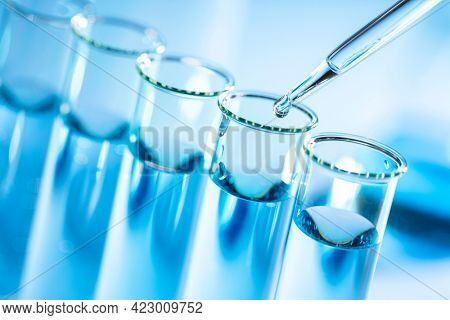 Laboratory glassware with a dropper and test tube, biotechnology and medical scientific research