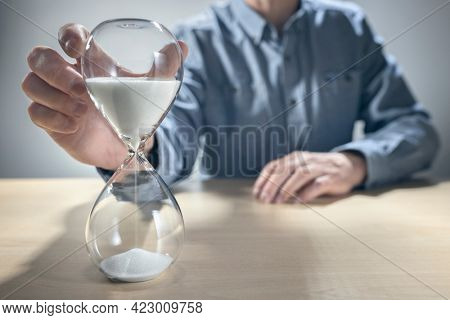 Hourglass timer concept for time slipping away for important appointment date, schedule and deadline