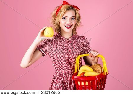 Smiling Woman With Shopping Basket And Apple In Hand. Happy Girl On Supermarket. Buying Spree. Femal