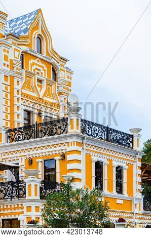 Sochi, Russia - October 26, 2019: Riviera Park. Khludov's Dacha. Yellow Facade. Grey Sky