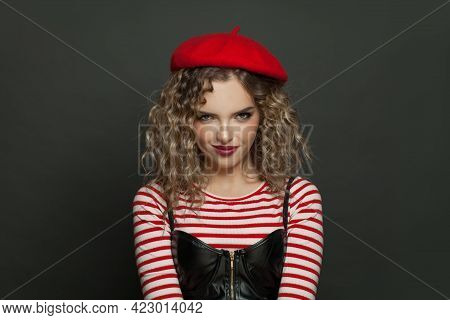 Woman In Red Beret On Black Background