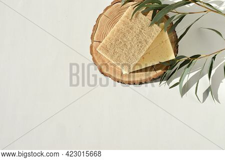 Eco-friendly Dish Sponges On A Wooden Catwalk With Natural Shadows. Copy Space. Empty Space.