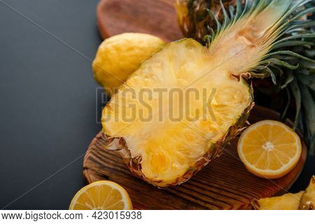 Pineapple On Cutting Board. Fresh Sweet Half Cut Pineapple. Sliced Pineapple Tropical Fruit Sliced W