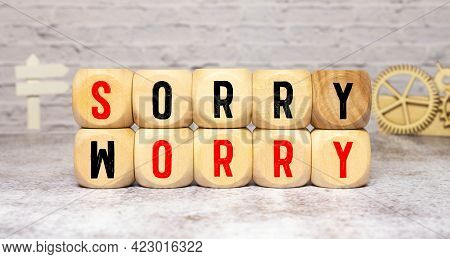 Sorry To Worry. Hand Turns A Dice And Changes The Word Worry To Sorry