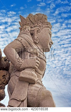 Image Of A Typical Balinese Sculpture Photographed Against The Blue Sky