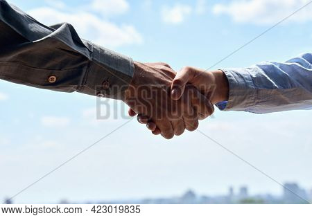 Closeup Shot Of Multiethnic Male Businessman Agent And Female Businesswoman Customer Shaking Hands A
