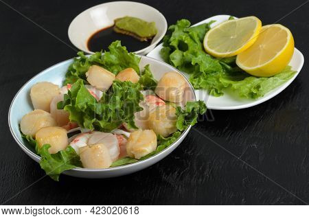 Fried Scallop Meat With Boiled Shrimps In A Ceramic Plate With Lettuce, Lemon, Soy Sauce And Wasabi