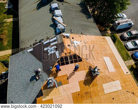 Removal Of Old Roof And Replacement Roofs With New Roof Shingle Being Applied Home Roof Construction