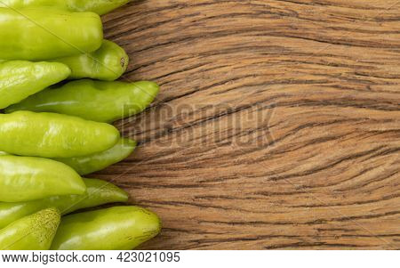 Green Cheiro (smell,scent) Peppers Over Wooden Table With Copy Space.