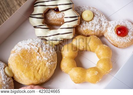 Different Type Of Donuts Set, Sweet Donuts In A Paper Donut Box Dessert Snack Food. Top View
