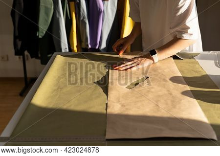 Fashion Collection Creation: Dressmaker Drafting Model Pattern On Textile. Professional Tailor Work