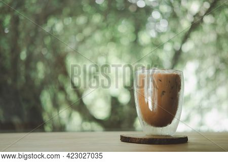 Iced Mocha Coffee In A Double-walled Glass On Wood Table