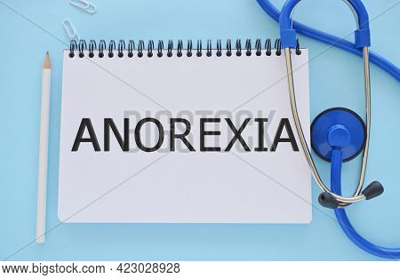 Anorexia Text Written In Notebook . Concept Image. Anorexia Syndrome