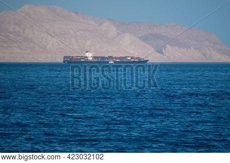 Bukha, Oman - May 28 2021: Iranian Coastline Near The Strait Of Hormuz. Giant Sea Container Ship In