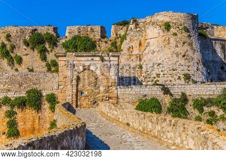 Venetian fort castle Methoni on the Greek Peninsula Peloponnese. The millennial protective walls were overgrown with bushes. The concept of active, photo, ecological and historical tourism