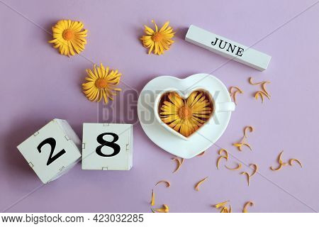 Calendar For June 28: The Name Of The Month Of June In English, Cubes With The Number 28, A Cup Of T