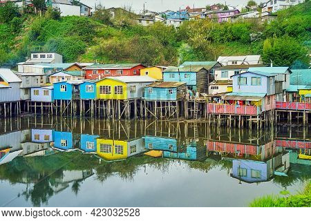 View Of Colorful Houses On Stilts At The Water Edge, In Castro, Chiloe Island. Chile