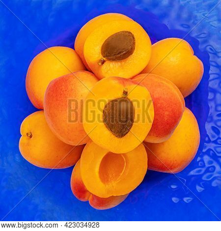 Fresh Apricot Fruits On A Blue Background. Sweet Apricots Pile, Top View